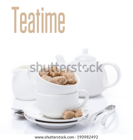 utensils for teatime and brown sugar, isolated on white - stock photo