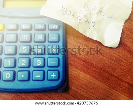 Utility bill and calculator, Vintage style - stock photo