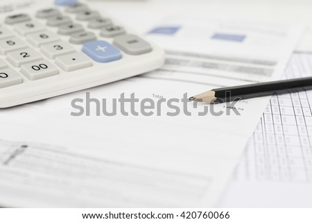 Utility bill and calculator with pencil, Selective focus - stock photo