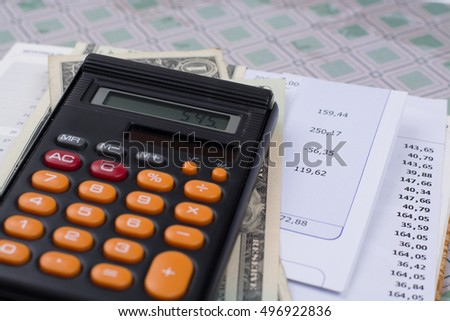 Utility or mortgage bills, calculator and US dollars - finance concept, payments and problems