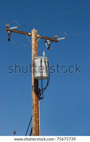 Utility pole with has a transformer in a suburban area. - stock photo