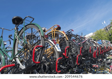 UTRECHT, NETHERLANDS - MAY 17, 2014: bicycle parking at the utrecht central station. As the largest train station in the netherlands, the bicycle parking is a main problem in the city
