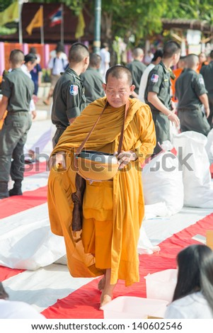 Uttaradit, THAILAND - MAY 23: People give food offerings to Buddhist monks on May 23, 2013 in Uttaradit, Thailand. Thai tradition