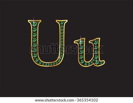 Uu in stunning emerald precious round jewels set into a 2-level gold gradient channel setting, isolated on black. High-resolution raster JPEG version.  - stock photo