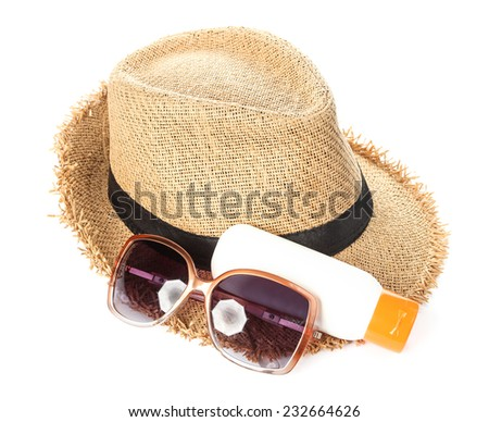UV protection equipment.  Sunglasses, hat and sunblock. - stock photo