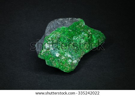 Uvarovite mineral on gray background