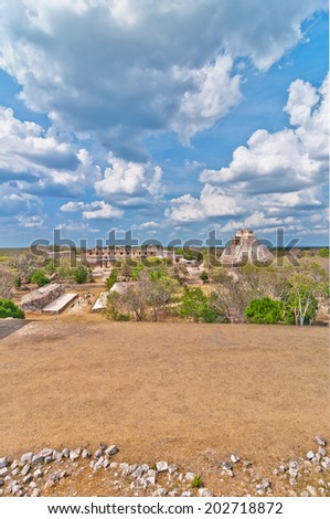 UXMAL, MEXICO - APRIL 19, 2014: tourists visit Uxmal ruins in Yucatan, Mexico. Uxmal is considered one of the most important archaeological sites of Maya culture.