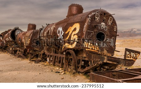 UYUNI - NOVEMBER 12:Cemetery locomotives and trains in the salt desert Uyuni on November 12, 2014 in Uyuni, Bolivia. This cemetery has become a popular place for tourists - stock photo