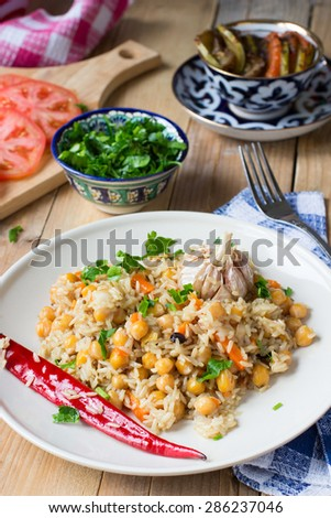Uzbek pilaf with chickpeas, garlic and spices. Vegan food
