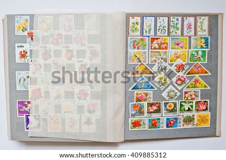 UZHGOROD, UKRAINE - CIRCA APRIL, 2016: Collection of postage letter with stamps in album printed  from different countries and times,  circa 1965-1980 - stock photo