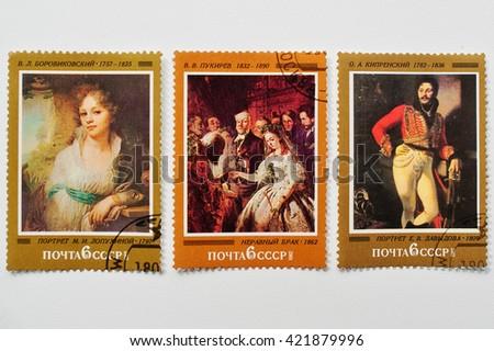 UZHGOROD, UKRAINE - CIRCA MAY, 2016: Collection of postage stamps printed in USSR shows works great russian painters as Vladimir Borovikovsky, Vasili Pukirev and Orest Kiprensky, circa 1982 - stock photo