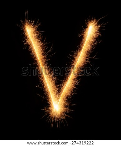 V letter drawn with bengali sparkles isolated on black background  - stock photo