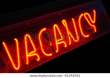 Vacancy sign outside hotel. - stock photo