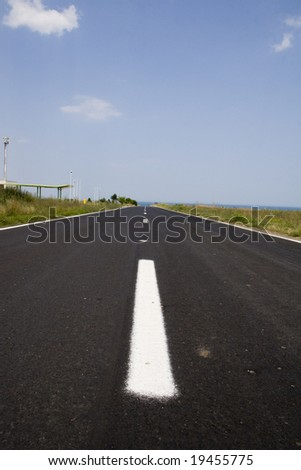 Vacant two-lane road with view from near center, diminishing perspective - stock photo