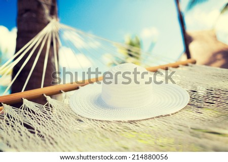 vacation and holiday concept - picture of hammock with white hat - stock photo