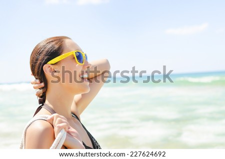 Vacation beach beautiful woman smiling happy portrait.