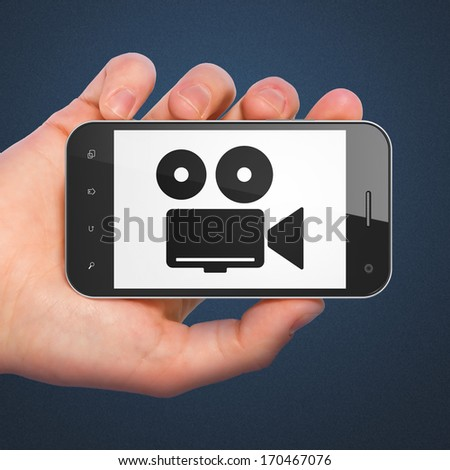 Vacation concept: hand holding smartphone with Camera on display. Mobile smart phone on Blue background, 3d render - stock photo