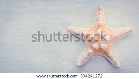 Vacation Detail Of A Starfish On A White Painted Backdrop - stock photo