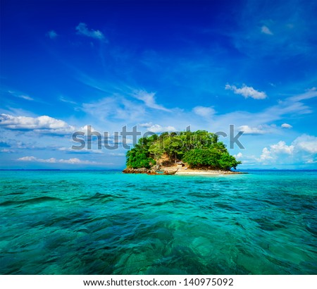 Vacation holidays concept background - tropical island and long-tail boat in sea. Thailand - stock photo