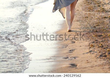 Vacation holidays.Feet closeup of relaxing on beach in sunny summer day. Girl footprint in the fine sand at the beach - stock photo