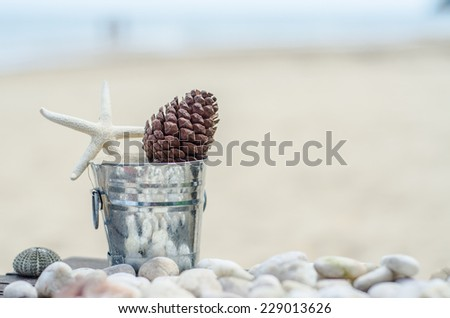 Vacation memories from the sea. Shells zinc bucket for postcard or Poster - stock photo