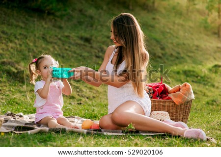 vacation, mother and daughter on picnic