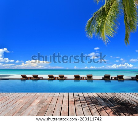Vacation on beach -- Tropical beach vacation and travel concept  - stock photo