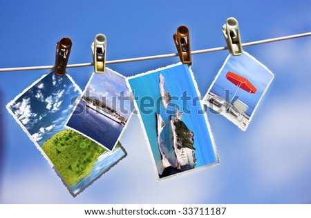 Vacation photos hanging on a clothesline