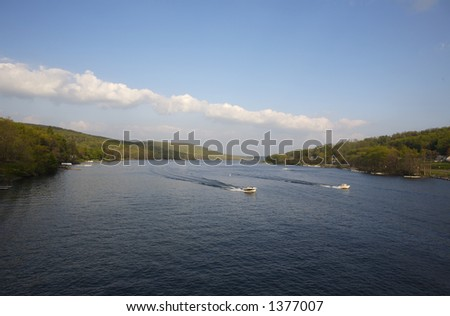 Vacation Resort Lake with Boats - stock photo
