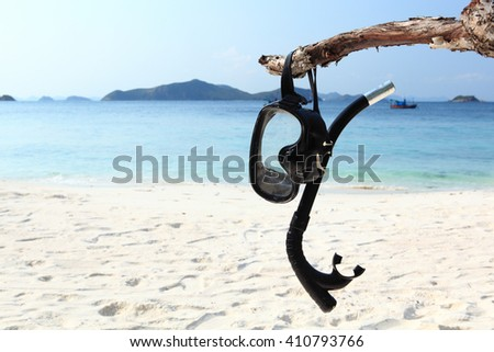 Vacation Start Here Concept, Scuba Diving Equipment or Snorkel gear  On The White Sea Sand Beach - stock photo