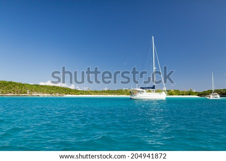 vacation, travel and sea concept - white boat at blue sea - stock photo