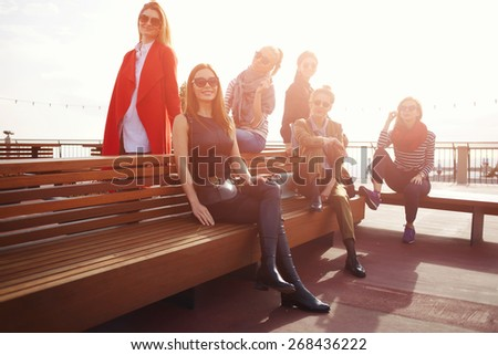 Vacation travel holidays wit best friends, group of attractive women having fun spending time together, group of smiling girlfriends posing together for vacation photo at sunny day - stock photo