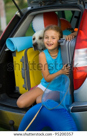Vacation, Travel - kid with dog ready for the travel for summer vacation - stock photo