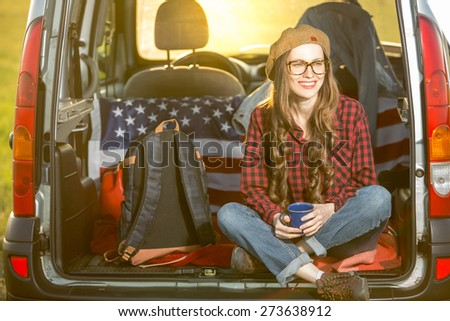 Vacation, travel - woman travel by car. baclkight, sunshine - stock photo