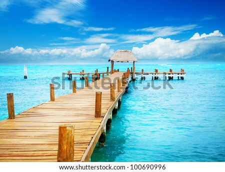 Vacations And Tourism Concept. Tropic Paradise. Jetty on Isla Mujeres, Mexico,Cancun - stock photo