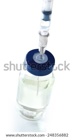 Vaccine in vial with syringe - stock photo