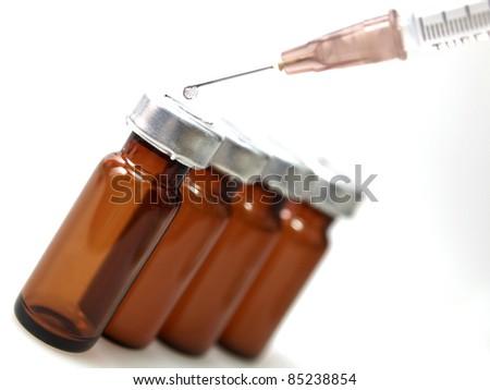 Vaccine vials with syringe - stock photo