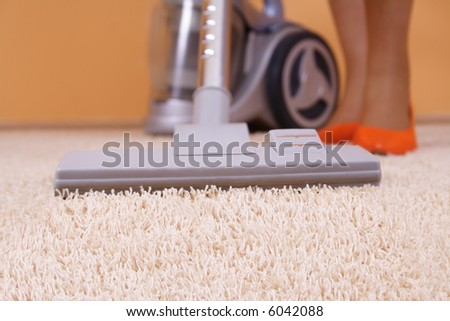 Vacuum cleaner in action - close up - stock photo