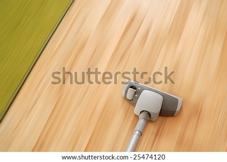 Vacuum cleaner in motion cleaning parquet floor and carpet