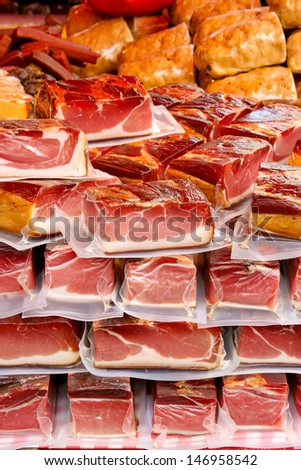 vacuum packed pieces of meat on a farmers market - stock photo