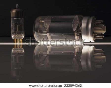 Vacuum tubes on black background  with reflection - stock photo