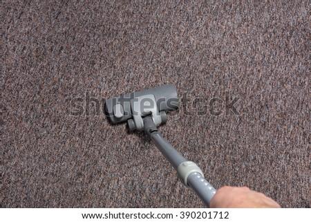 Vacuuming carpet in home
