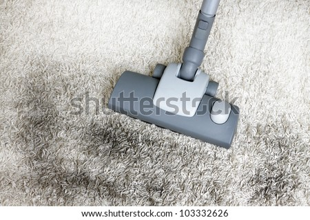 Vacuuming very dirty white  carpet - stock photo