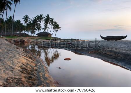 Vakala beach with fishing ship at the sunset - stock photo