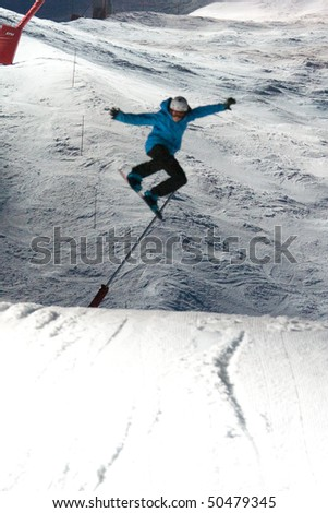 VAL D'ISERE, FRANCE - MARCH 24: Nocturnal White Battle Snowboard Jumps Competition at the bottom of Le Face slope, March 24, 2010, Val d'Isere, France - stock photo