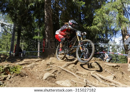 Val Di Sole, Italy - 22 August 2015: Madison Saracen Factory Team,  Rider Dale Sam in action during the mens elite Downhill final World Cup at the Uci Mountain Bike in Val di Sole, Trento, Italy