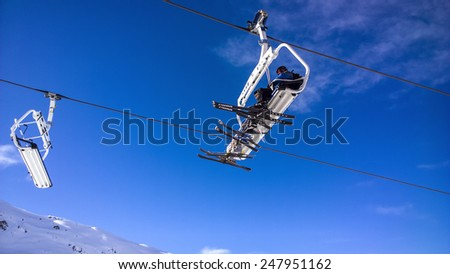 Val Thorens, France -  January  15, 2015: People using a chair lift at Val Thorens Ski Resort