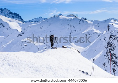 VAL THORENS, FRANCE - JANUARY 27, 2016: Photographer filming in the mountains. Ski resort  Val Thorens. France