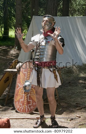 "VAL VENY, ITALY - JULY 2: ""Sagitta Barbarica"" man disguised as ancient Roman soldier at ""Celtica"" festival dedicated to ancient and modern Celts on July 2, 2011 in the Peuterey Woods, Val Veny, Italy."