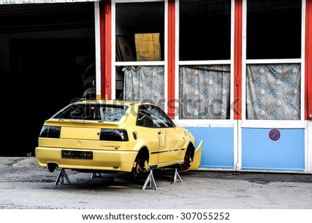 VALAIS, SWITZERLAND - AUGUST 5, 2014: Motor car Volkswagen Scirocco at the abandoned service station in the small Apline village. - stock photo